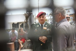 Hector Barajas behind the border wall.  Photo by Maria Teresa Fernandez